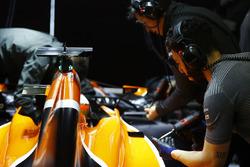 Mechanics at work on the McLaren MCL32
