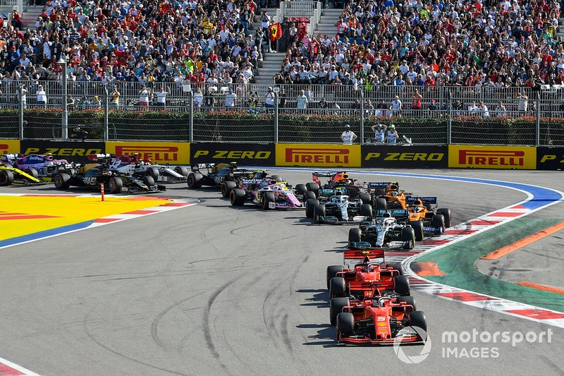 Sebastian Vettel, Ferrari SF90, leads Charles Leclerc, Ferrari SF90, Lewis Hamilton, Mercedes AMG F1 W10, Carlos Sainz Jr., McLaren MCL34, Valtteri Bottas, Mercedes AMG W10, Lando Norris, McLaren MCL34 and the rest of the pack at the start