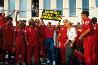 Michael Schumacher celebrates his fourth World Championship with members of the Ferrari team and his wife Corinna