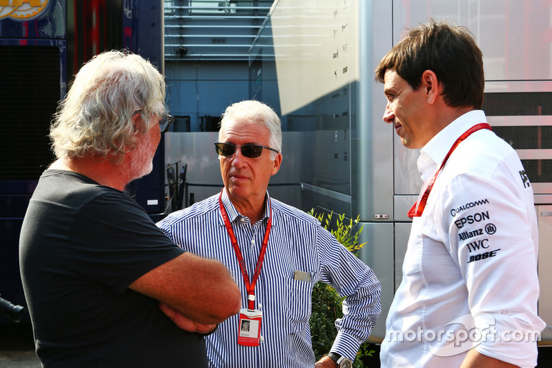 (L to R): Flavio Briatore, with Piero Ferrari, Ferrari Vice-President and Toto Wolff, Mercedes AMG F1 Shareholder and Executive Director