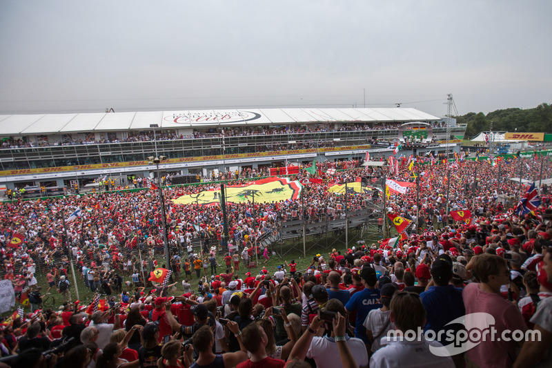 Fans on track after the race