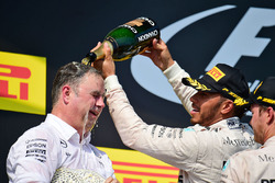 Ron Meadows, Mercedes GP Team Manager celebrates on the podium with Lewis Hamilton, Mercedes AMG F1