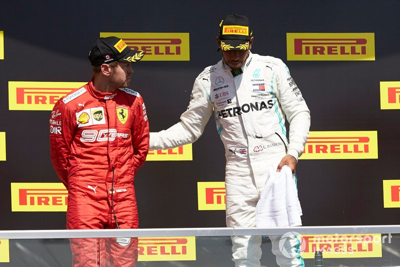 Lewis Hamilton, Mercedes AMG F1, 1st position, consoles Sebastian Vettel, Ferrari, 2nd position, on the podium