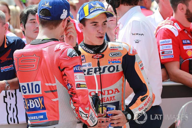 Ganador de la pole Marc Marquez, Repsol Honda Team, tercero Jorge Lorenzo, Ducati Team