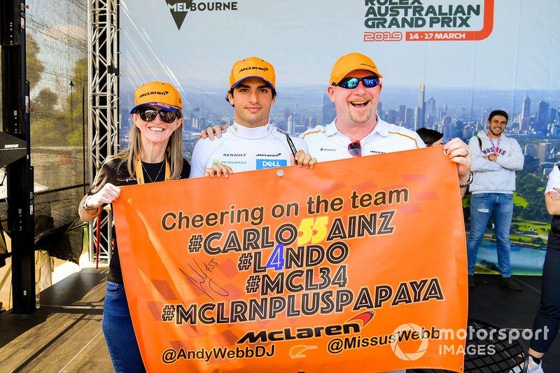 Carlos Sainz Jr., McLaren, poses with fans