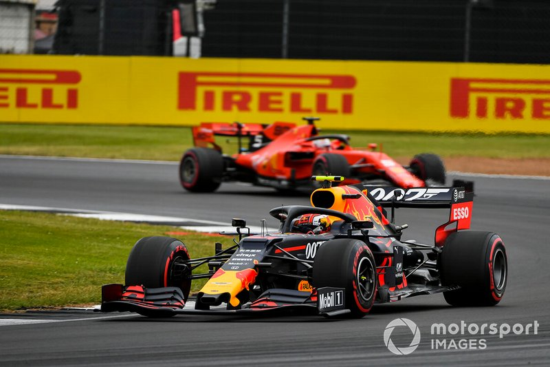 Pierre Gasly, Red Bull Racing RB15, leads Sebastian Vettel, Ferrari SF90