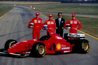 Eddie Irvine (left), Nicola Larini, Luca Di Montezemolo and Michael Schumacher (right)