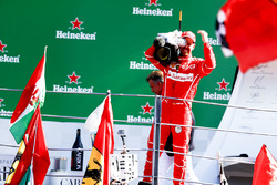Third place Sebastian Vettel, Ferrari, borrows a TV camera to film the crowd