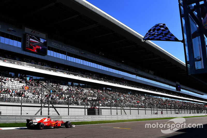 Sebastian Vettel, Ferrari SF70H takes the chequered flag