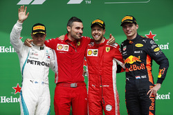 Sebastian Vettel, Ferrari, celebrates on the podium with Valtteri Bottas, Mercedes AMG F1 and Max Ve