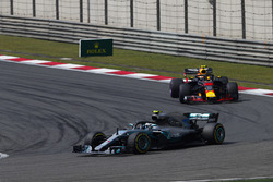 Valtteri Bottas, Mercedes AMG F1 W09, leads Max Verstappen, Red Bull Racing RB14 Tag Heuer