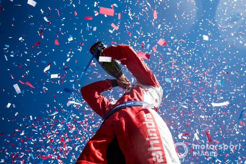 Pascal Wehrlein, Mahindra Racing, celebrates his maiden podium finish on the podium