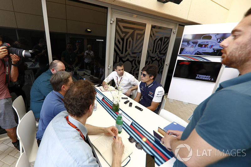 Lance Stroll, Williams Racing, talks to the press