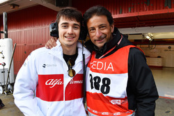 Charles Leclerc, Alfa Romeo Sauber F1 Team and Jean-Michel Tibi, FOM Cameraman