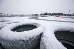 Snow covered tires overlooking the circuit