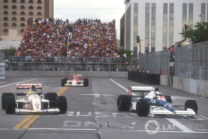 Jean Alesi Tyrrell 018 Ford prend un tour à Michele Alboreto, Arrows A11B Ford devant Ayrton Senna, Mclaren MP4/5B Honda