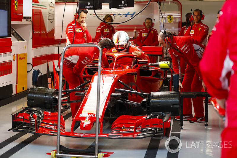 Sebastian Vettel, Ferrari, climbs into his car