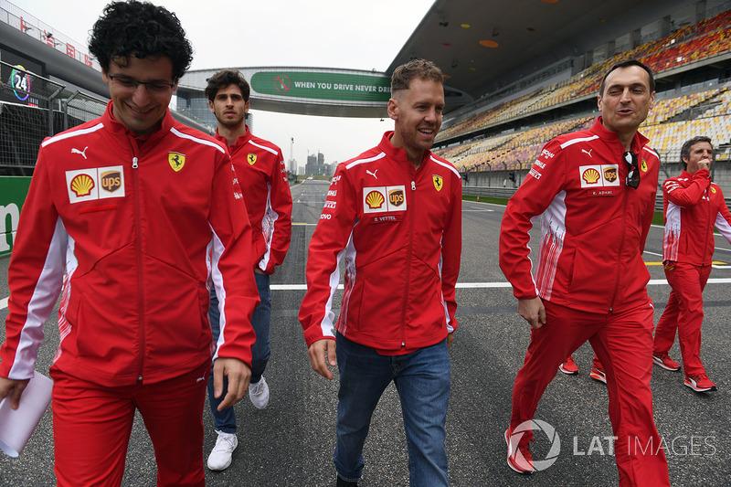 Sebastian Vettel, Ferrari walks the track with Riccardo Adami, Ferrari Race Engineer