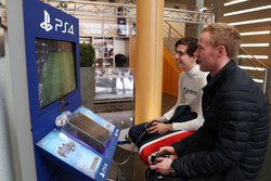 Drivers playing Fifa on the Playstation