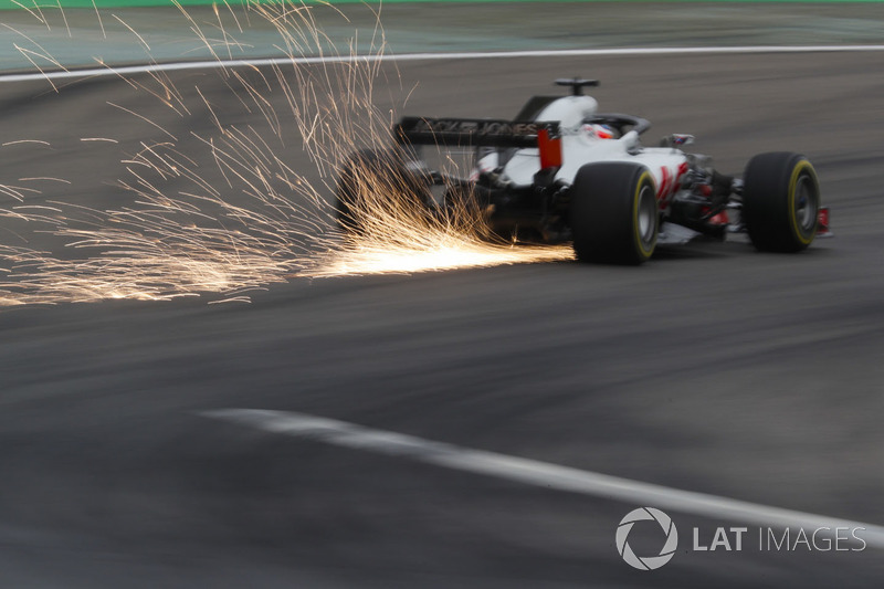Romain Grosjean, Haas F1 Team VF-18 Ferrari, srikes up sparks