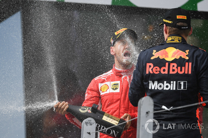 Race winner Sebastian Vettel, Ferrari and Max Verstappen, Red Bull Racing celebrate on the podium wi