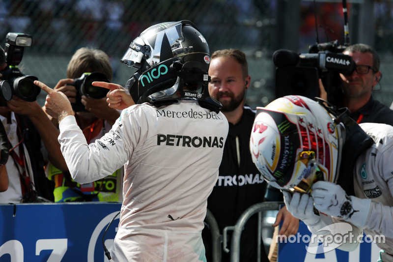 Race winner Nico Rosberg, Mercedes AMG F1 celebrates in parc ferme as his third placed team mate Lewis Hamilton, climbs from his Mercedes AMG F1 W07 Hybrid