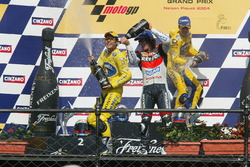 Podium: race winner Makoto Tamada, Honda, second place Max Biaggi, Honda, third place Nicky Hayden, Repsol Honda Team