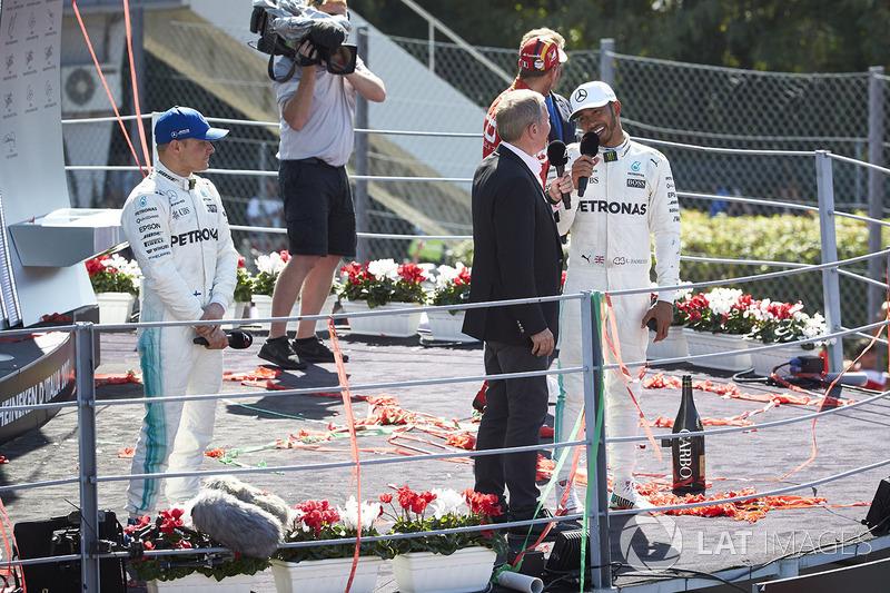 Martin Brundle, Sky Sports F1, interviews Race winner Lewis Hamilton, Mercedes AMG F1, on the podium