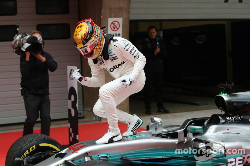 Race winner Lewis Hamilton, Mercedes AMG, celebrates in Parc Ferme