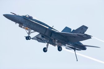 An F/A-18A Hornet of 77 Squadron RAAF performs a dirty pass for the crowds