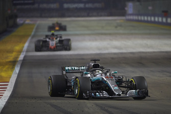 Lewis Hamilton, Mercedes AMG F1 W09 EQ Power+, leads Kevin Magnussen, Haas F1 Team VF-18, and Max Verstappen, Red Bull Racing RB14