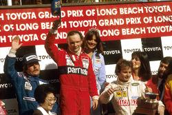Podium: Race winner Niki Lauda, McLaren Ford; second place Keke Rosberg, Williams Ford; third place Gilles Villeneuve, Ferrari