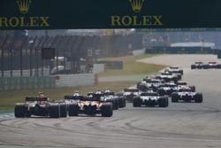 Daniel Ricciardo, Red Bull Racing RB14, chases a McLaren