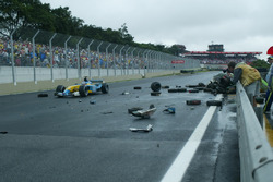 Jarno Trulli, Renault Renault F1 Team R23, passes the wreck of both cars