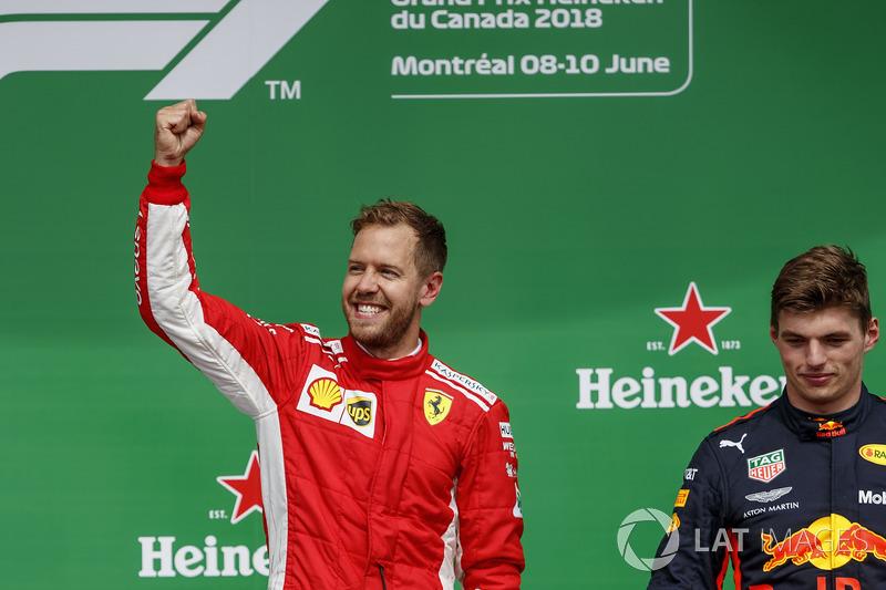Sebastian Vettel, Ferrari, 1st position, celebrates alongside Max Verstappen, Red Bull Racing, 3rd p