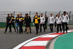 Carlos Sainz jr, Renault Sport F1 Team and Kevin Magnussen, Haas F1 Team walk the track