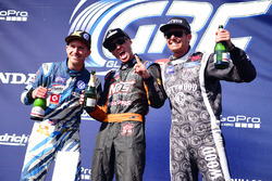 Podium: winner Brian Deegan, Ford, second place Scott Speed, Andretti Autosport, third place Patrik Sandell, Bryan Herta Rallysport