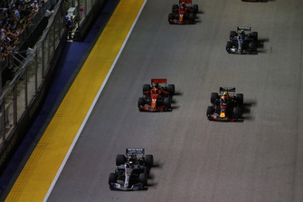 Lewis Hamilton, Mercedes AMG F1 W09 EQ Power+, leads Max Verstappen, Red Bull Racing RB14, and the rest of the field away at the start