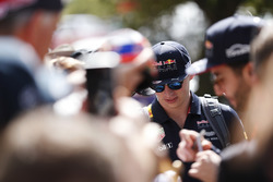 Max Verstappen, Red Bull Racing, and Daniel Ricciardo, Red Bull Racing, sign autographs for fans