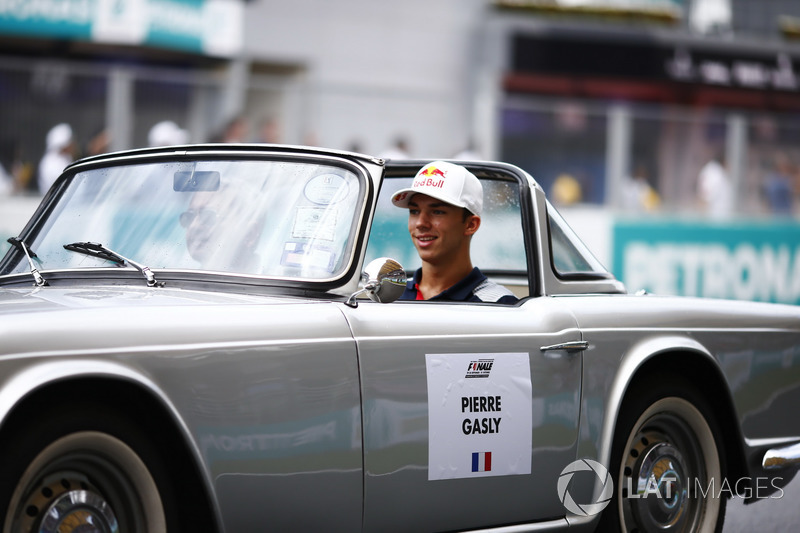 Pierre Gasly, Reserve Driver, Scuderia Toro Rosso, rides in a Triumph TR on the drivers parade