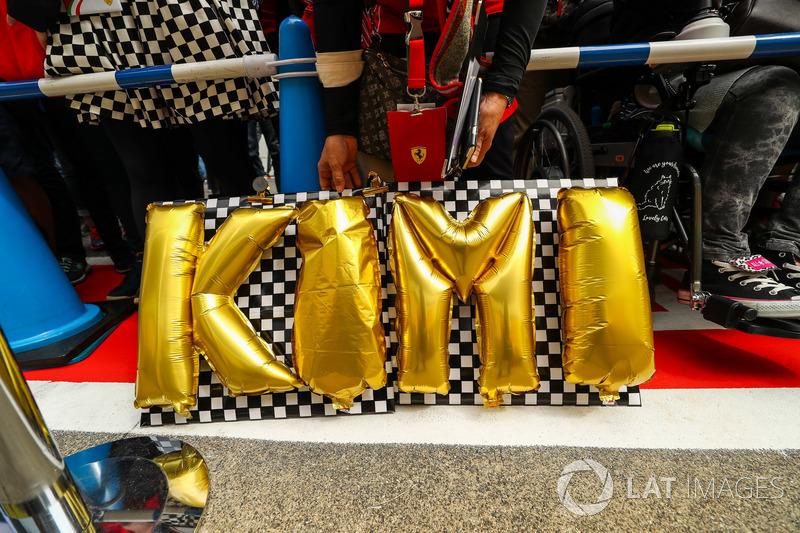 Kimi Raikkonen, Ferrari fans and banner