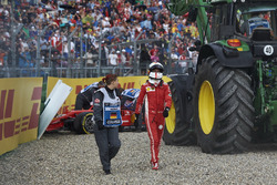 Sebastian Vettel, Ferrari SF71H, walks away from his car after crashing out from the lead