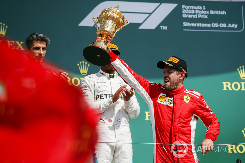Race winner Sebastian Vettel, Ferrari, celebrates on the podium