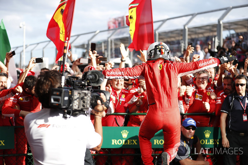 Sebastian Vettel, Ferrari SF71H, jumps for joy in parc ferme, after taking victory