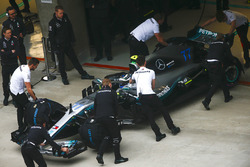 Valtteri Bottas, Mercedes AMG F1 W09, is returned to the garage