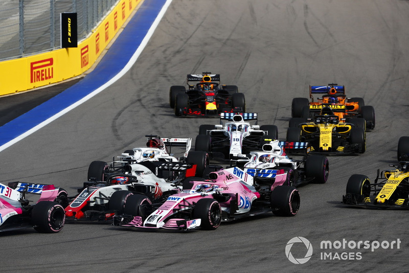 Romain Grosjean, Haas F1 Team VF-18, leads Sergio Perez, Racing Point Force India VJM11, Marcus Ericsson, Sauber C37, Sergey Sirotkin, Williams FW41, Lance Stroll, Williams FW41, Carlos Sainz Jr., Renault Sport F1 Team R.S. 18, Nico Hulkenberg, Renault Sport F1 Team R.S. 18, Fernando Alonso, McLaren MCL33, and Max Verstappen, Red Bull Racing RB14, at the start