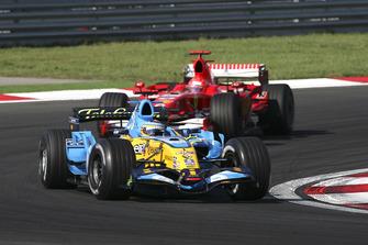 Fernando Alonso, Renault R26, leads Michael Schumacher, Ferrari 248 F1