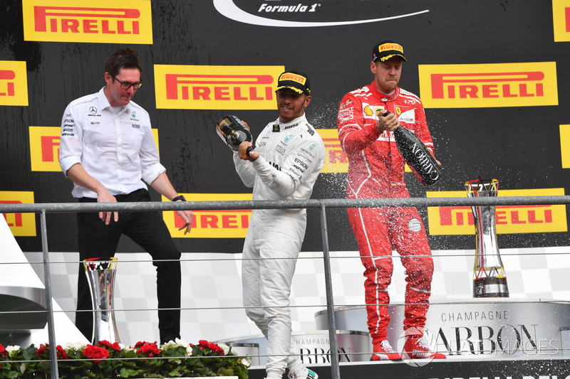 Andy Shovlin, Mercedes AMG F1 Engineer, Lewis Hamilton, Mercedes AMG F1 and Sebastian Vettel, Ferrari celebrate on the podium