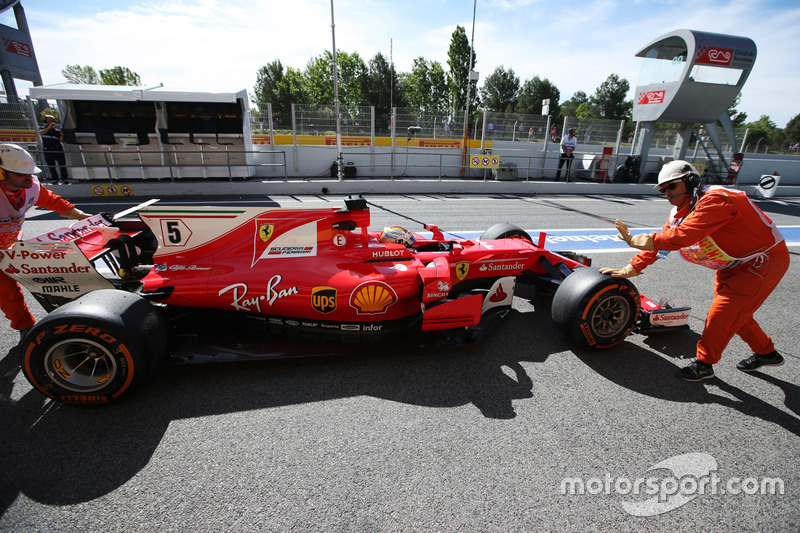 Sebastian Vettel, Ferrari SF70H, gets a push back from some marshals