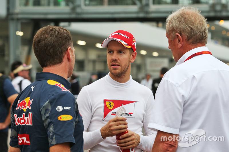 (L to R): Christian Horner, Red Bull Racing Team Principal with Sebastian Vettel, Ferrari and Dr Helmut Marko, Red Bull Motorsport Consultant